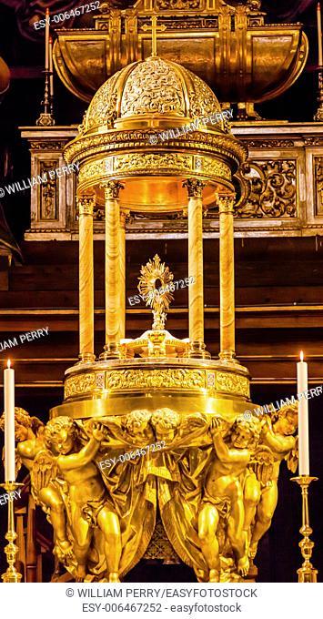 Golden Baptismal Font Basilica Santa Iglesia Collegiata de San Isidro Madrid Spain. Named after Patron Saint of Madrid, Saint Isidore