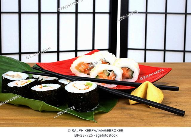 Sushi with chopsticks and fortune cookie