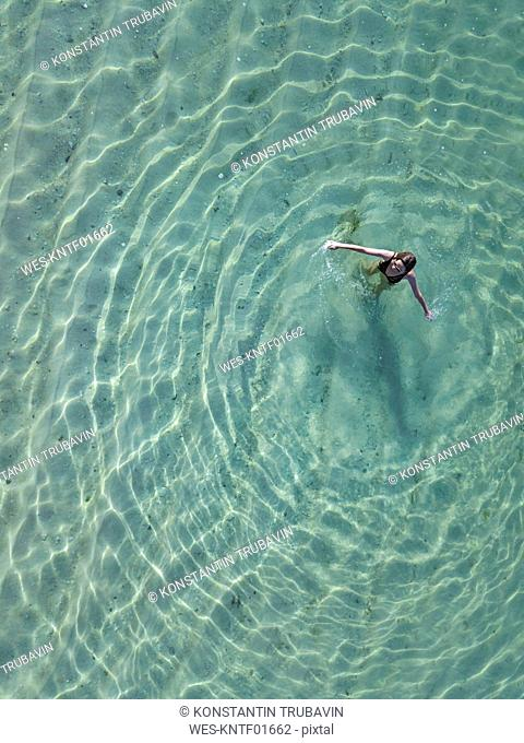 Indonesia, Bali, Melasti, Aerial view of Karma Kandara beach, one woman in water