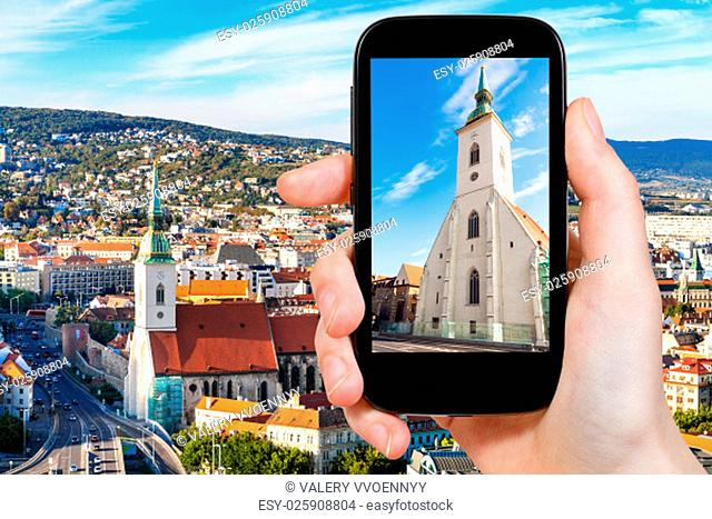 travel concept - tourist snapshot of facade of St. Martin Cathedral in Bratislava town on smartphone