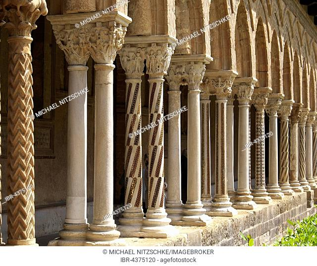 Cloister with ornate pillars in the courtyard of Monreale Cathedral, Monreale, Sicily, Italy