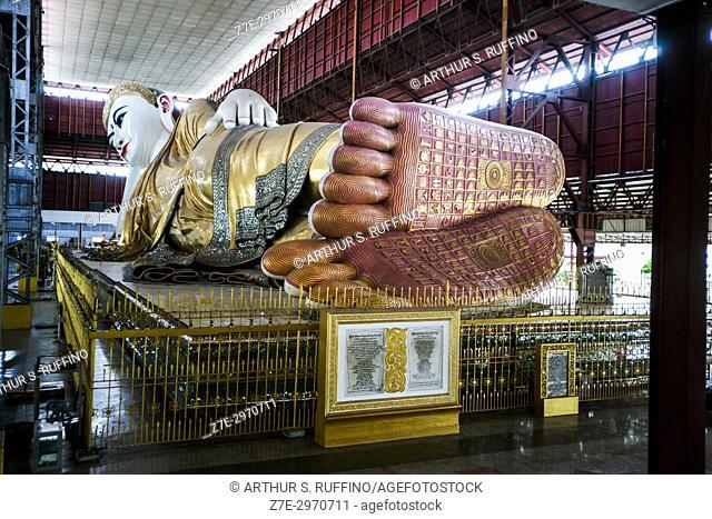 Long angle of the reclining Buddha taken from beyond the soles of the statue's feet. Chauk Htat Gyi Pagoda, Yangon, Myanmar