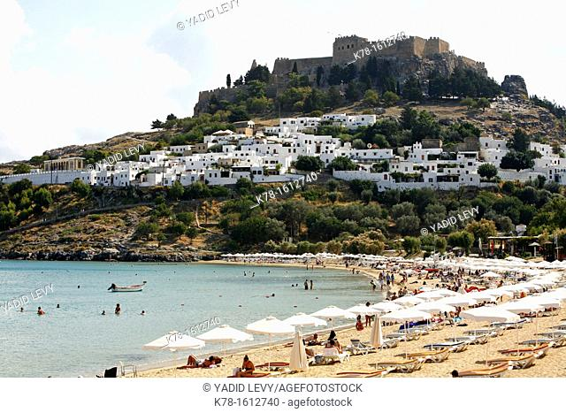 View over Lindos the main beach and the acropolis, Rhodes, Greece