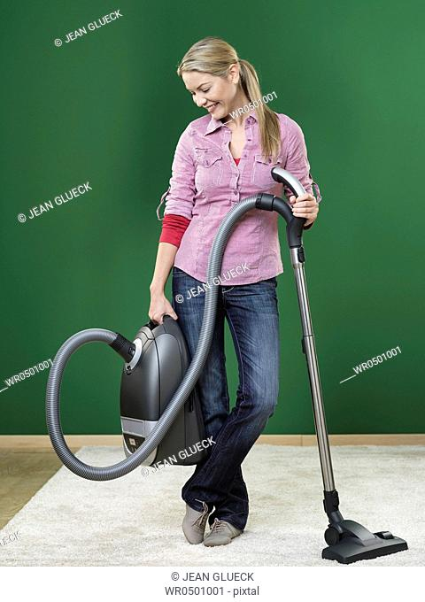Woman hoovering