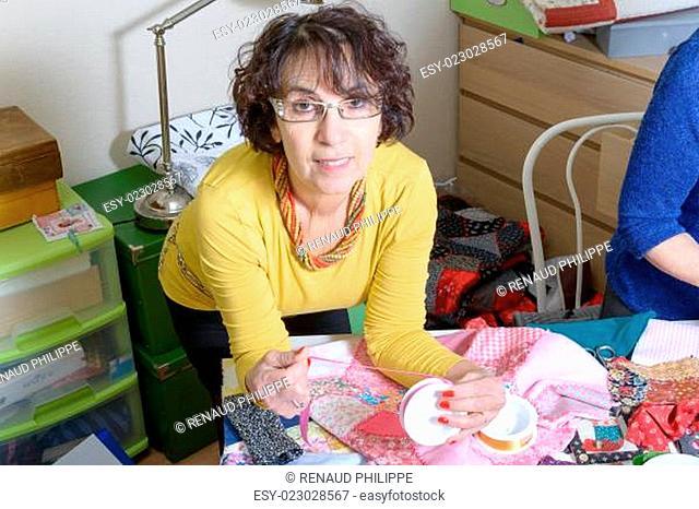 dressmaker working on her quilt