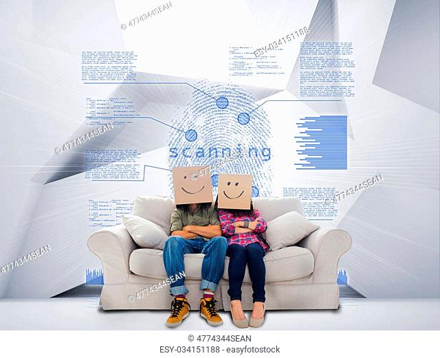 Couple with cartons on head sitting on couch under blue holographic finger print on white background