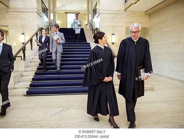 Judges and lawyers walking through courthouse
