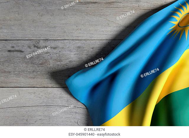 3d rendering of Republic of Rwanda flag waving on wooden background