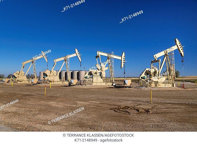 Oil pumpers in the Bakken play oil fields near Williston, North Dakota, USA