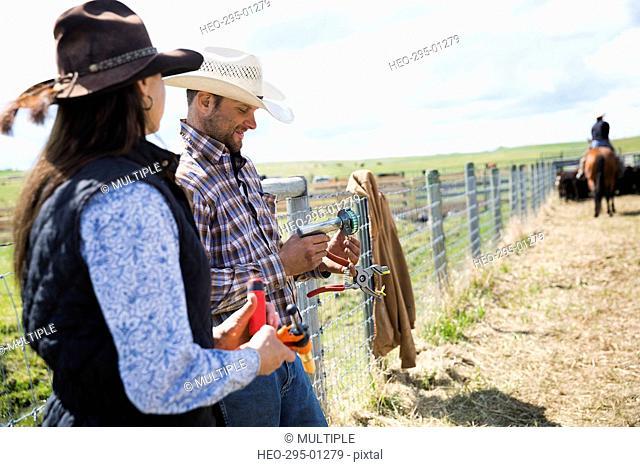 Cattle ranchers preparing vaccination equipment