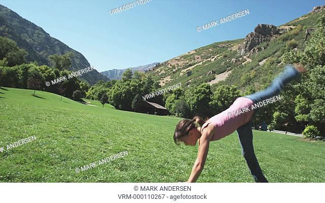 girl doing cartwheels