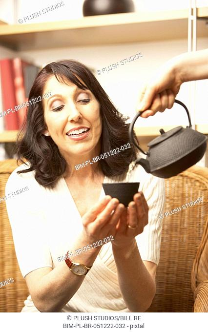 Woman being served tea, San Rafael, California, United States
