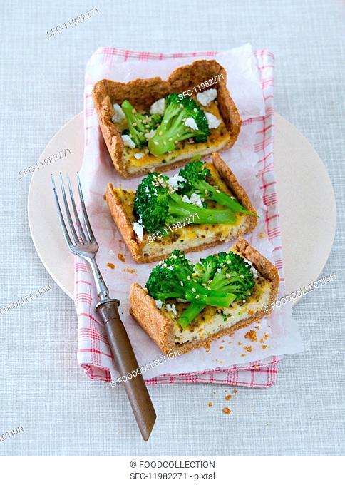 Broccoli and sheep's cheese quiche cut into slices