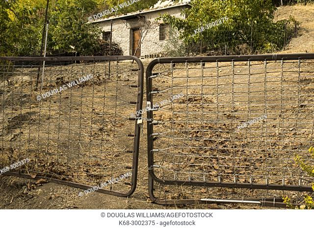 Closed gate made from bed springs, Alpujarras, Andalusia, Spain