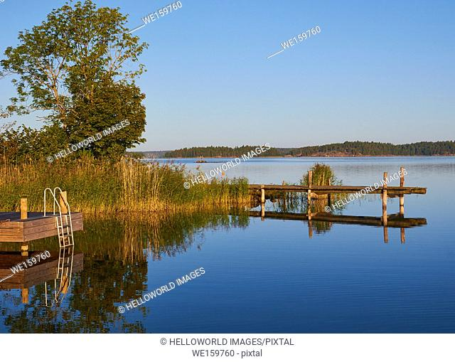 Wooden platforms and steps on lake, Ljustero, Stockholm County, Sweden, Scandinavia. . Ljustero is an island in the northern part of the Stockholm archipelago