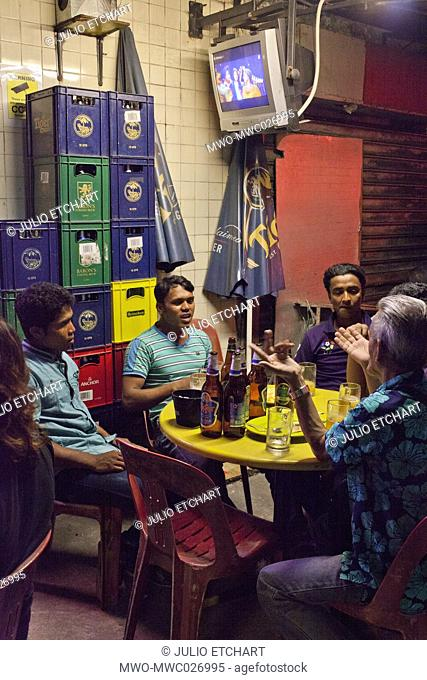 Migrant workers relaxing in Little india on a Sunday night. Singapore