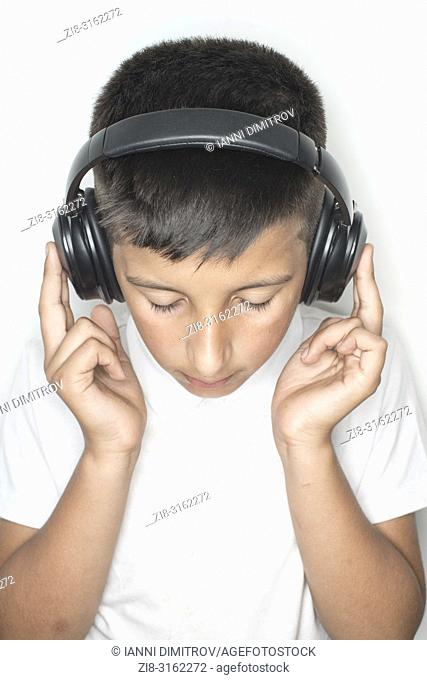 Boy,10-11 years old listens music on headphones