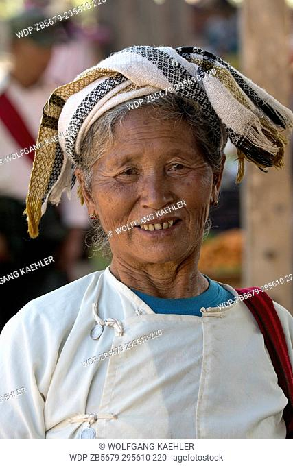 A portrait of a local tribal woman on the market in the village of Khaung Tai on Inle Lake in Myanmar