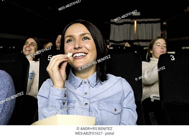 Woman watching a movie in a cinema