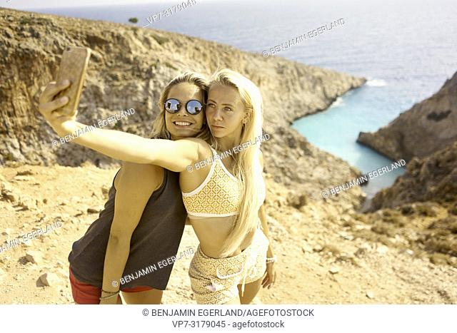 two women taking selfie at Seitan Limania Beach, Crete, Greece