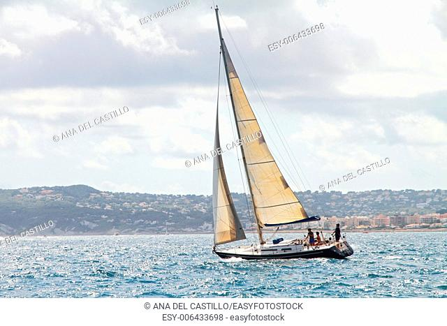 Seascape with sailboat the background of the cloudy sky Javea Spain