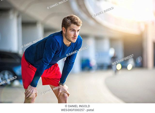 Young sporty man taking a break