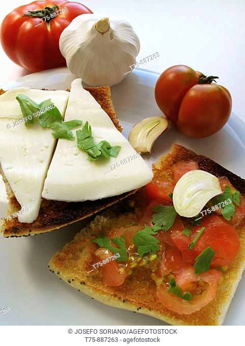 Toast with garlic, oil, tomato, cheese and parsley