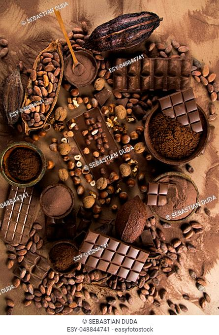 Milk and dark chocolate on a natural paper background