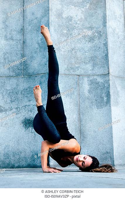 Woman in Arm Balance pose (Eka Pada Koundinyasana)