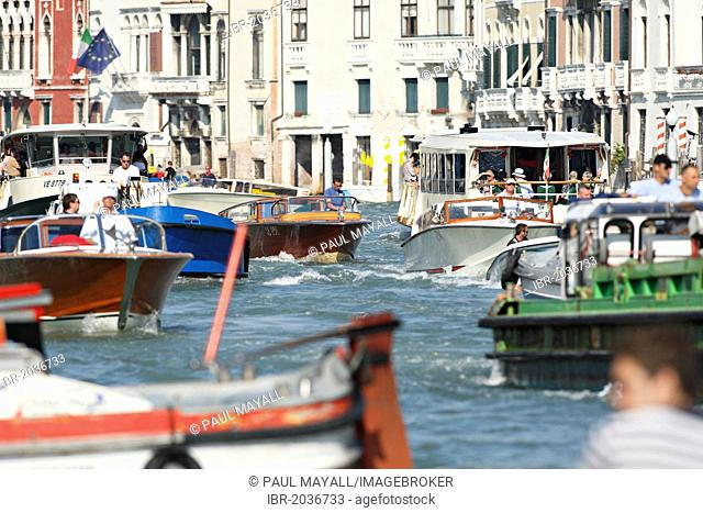 Peak hour morning boat traffic on the Canal Grande, Venice, Italy, Europe