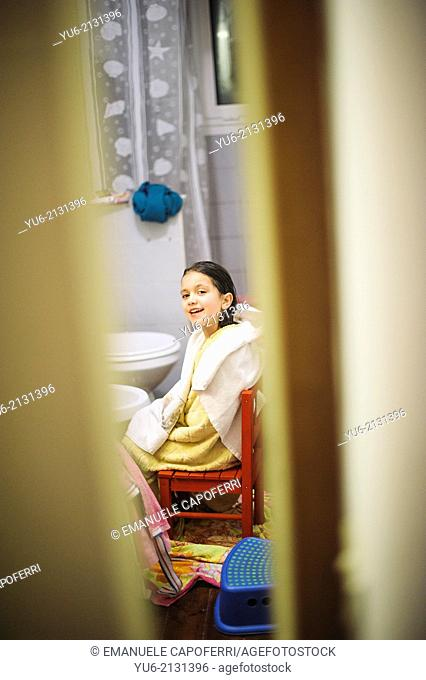 Girl with towel sitting in the bathroom after the shower