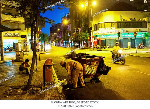 Early morning street sweepers in Ho Chi Min City (Saigon). Vietnam