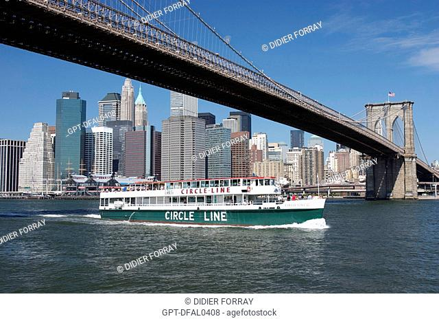 A CIRCLE LINE BOAT PASSING UNDER THE BROOKLYN BRIDGE, EAST RIVER, MANHATTAN, NEW YORK CITY, UNITED STATES OF AMERICA, USA