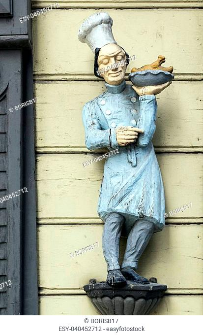 wooden figure of the cook on the building in the city of Wernigerode