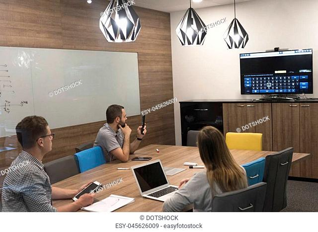 startup business team brainstorming on meeting working on laptop and tablet computer