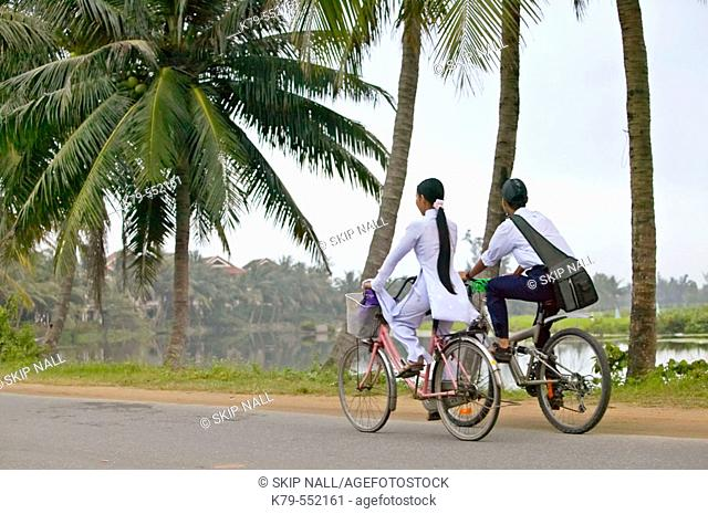 Students on bicycles near Hoi An