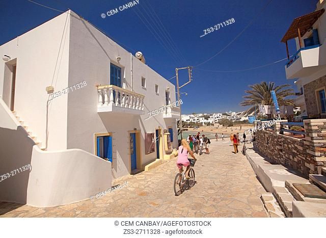 Cyclists near the main beach in town center, Koufonissi, Cyclades Islands, Greek Islands, Greece, Europe