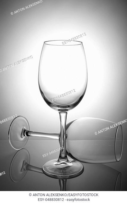 Two empty wine glasses isolated on white background