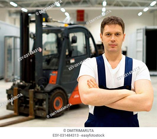 Handsome forklift operator in the warehouse
