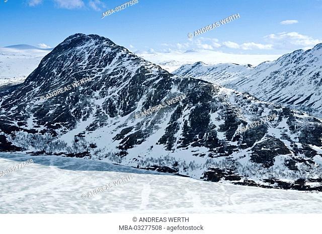 In the Besseggengrat, known footpath in the Jotunheimen National Park, smallest narrow of the ridge, 'Tying', in the icebound lake Bessvatn