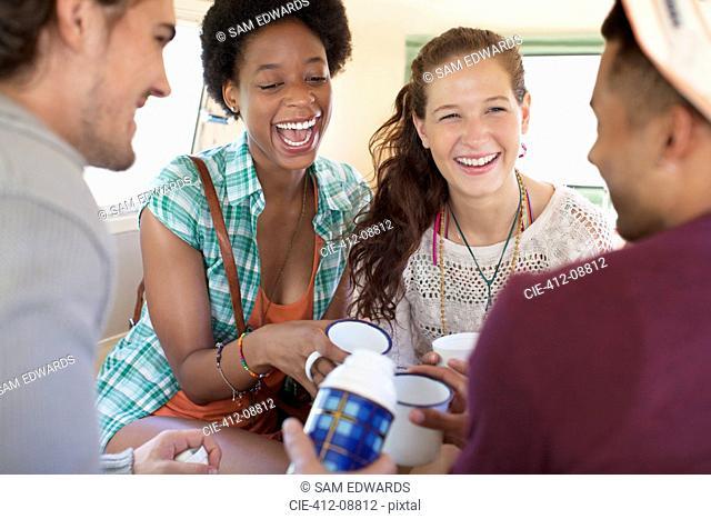 Friends drinking tea in van