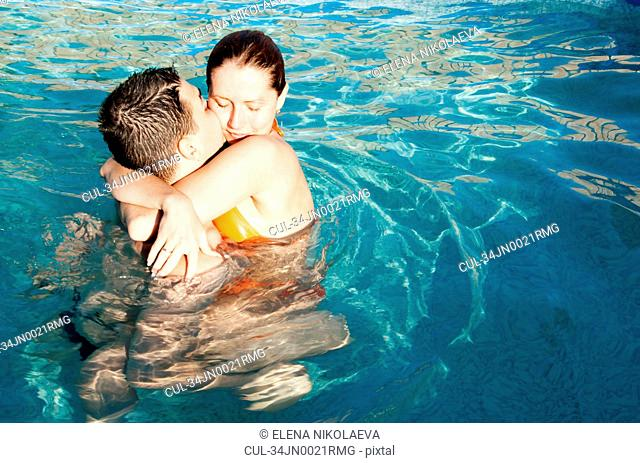 Couple kissing in pool