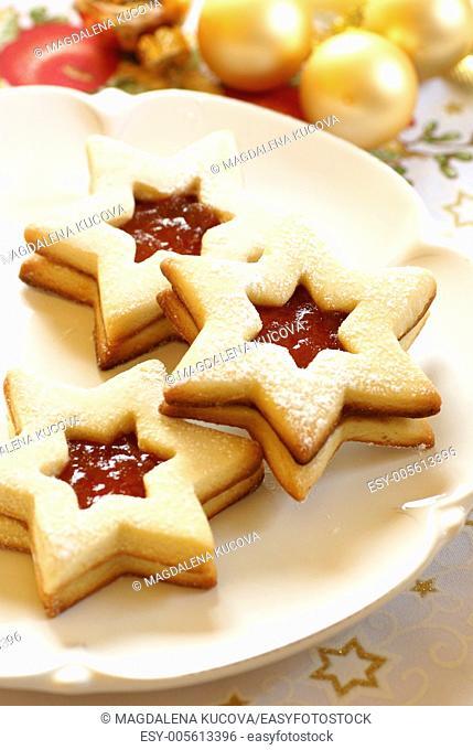 Christmas cookies on plate and Christmas ornaments
