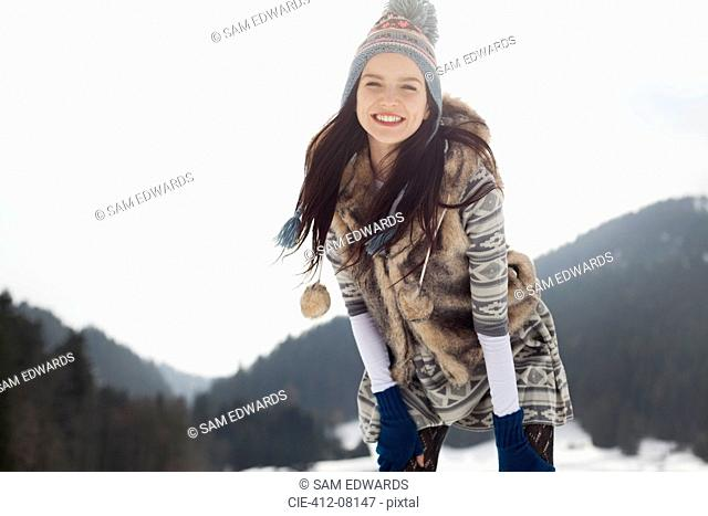 Portrait of happy woman in snow