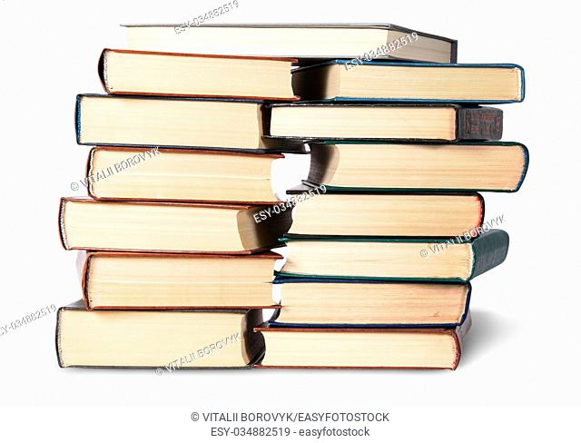 Two stacks chaotically stacked old books isolated on white background