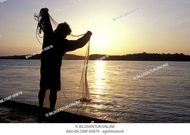 A fisherman on the river Danube in the city of Ruse in Bulgaria on the border to Romania