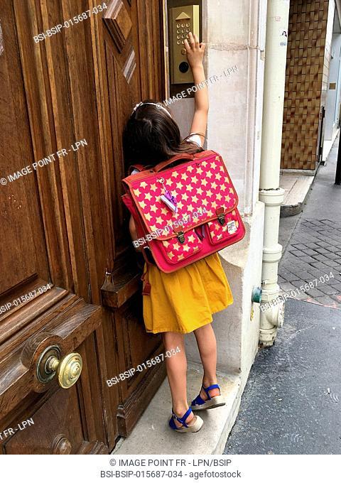Girl ringing doorbell