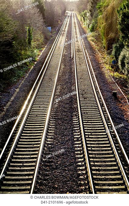 Railway lines pair recede into distance
