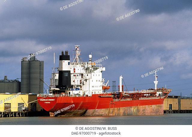 Cargo ship and port facilities, Harbor Navigation Canal, New Orleans, Louisiana, United States of America