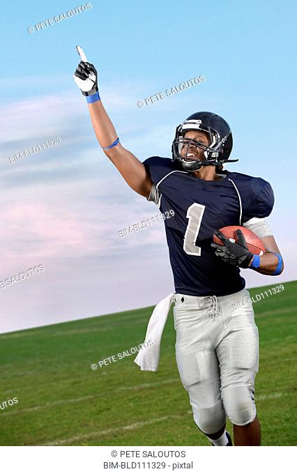 African American football player cheering in game